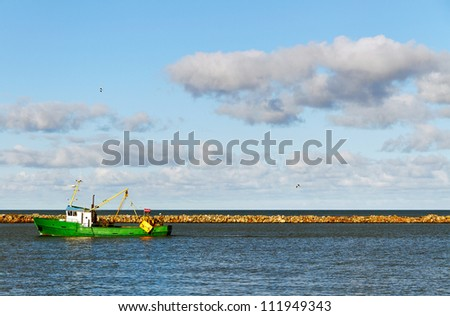 Fish ship in the dock of Baltic sea.