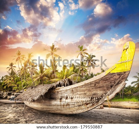 Fisherman boat on the beach at sunset sky in India
