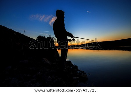 fishing at sunset near the sea in summer