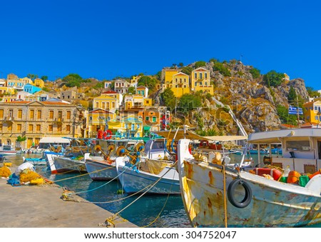 Fishing boats in the pictorial port of Symi island in Greece