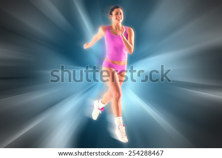 Fit brunette running and jumping against abstract background