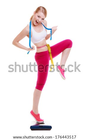 Fit fitness woman with measure tape happy blonde girl on weight scale celebrating weightloss progress after diet, she lost some weight. Healthy lifestyles concept