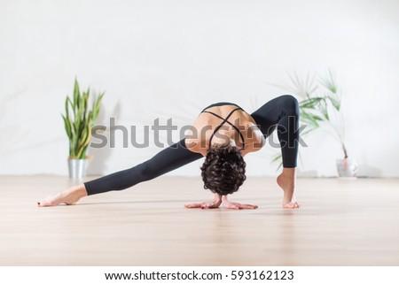 mature woman yoga posture bakasana crow stock photo