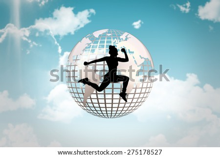 Fit woman silhouette against blue sky