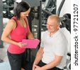 Fitness center personal plan happy active man with trainer - stock photo