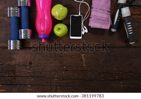 Fitness concept. Various elements over a wooden background