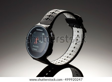 Fitness garmin 230 watch 2016 on dark background studio shot
