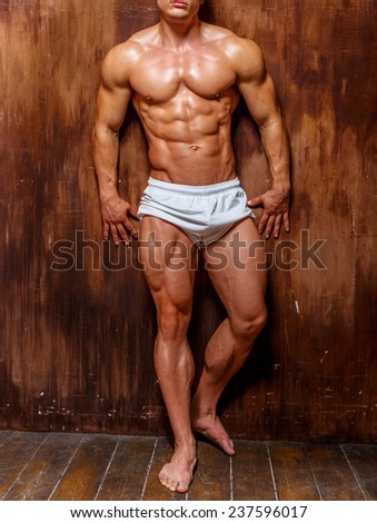 Fitness. Handsome man with perfect body.studio shot .