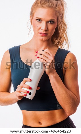 Fitness model posing with water bottle for hydration