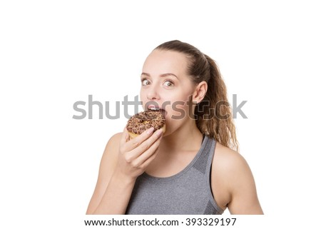 fitness woman eating a cheeky donut