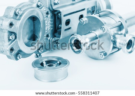 Fittings and ball valve with selective focus on thread fittings. Selective focus. Technical blue colored.