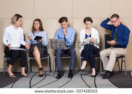 Five Applicants for Corporate Job Sitting in Line