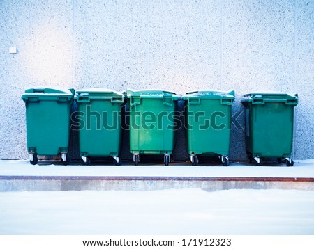 five green waste containers in a row