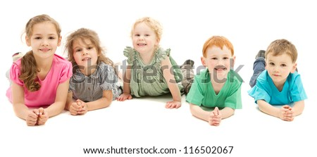 Five happy smiling kids lying in line on floor. On white.