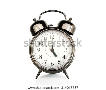 Five on an old vintage alarm clock isolated on white background