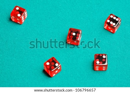 Five red dices on the green cloth