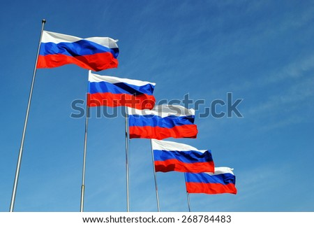 Five Russian flags in sunny day