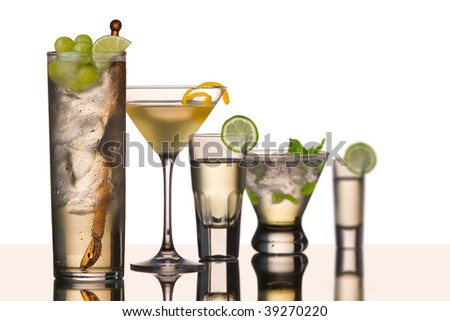five vodka drinks on glass surface with reflection, white background, large drinks on left is sharp other drinks fall out of focus