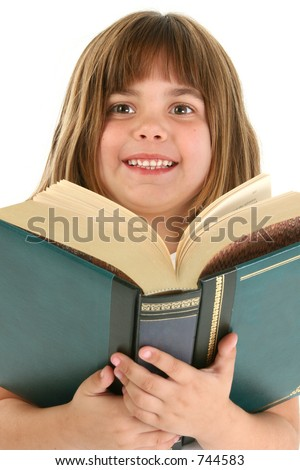 Five year old caucasian girl with large book.  Shot in studio over white.