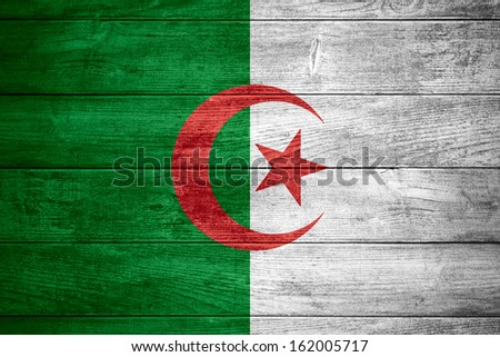 flag of Algeria or Algerian banner on wooden background