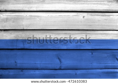 Flag of Krakow, Poland, painted on old wood plank background