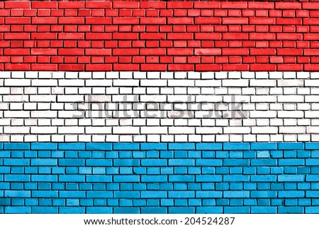 flag of Luxemburg painted on brick wall