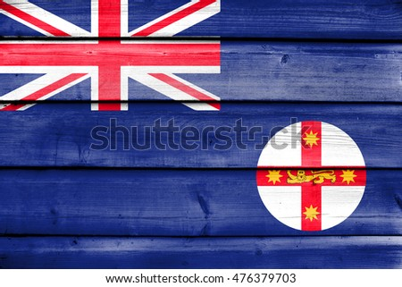 Flag of New South Wales State, Australia, painted on old wood plank background
