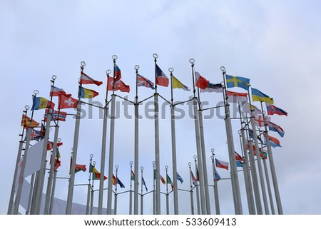 Flags of the countries of the European Union in cloudy weather