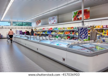 FLANDERS, BELGIUM - OCTOBER 20, 2015: Frozen food in freezer section of an Aldi discount supermarket, Aldi is a global discount supermarket chain with over 9,000 stores in over 18 countries.