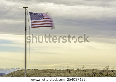Flapping in the wind is stars and strip flag
