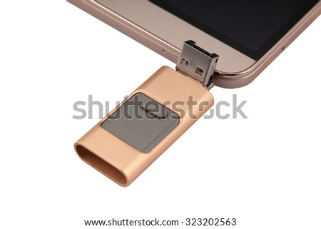 Flash Drive with Multi Functional interface for conversion between standard USB to  mini USB with anodized aluminum housing of golden color connected to a large screen phablet
