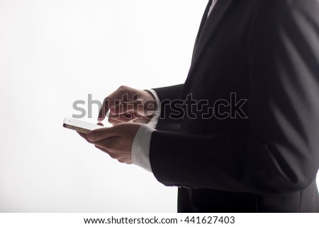 Flat cell phone in business man hand on white background