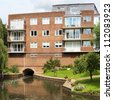 flats apartments alongside river avon stratford upon avon warwickshire the midlands england uk - stock photo