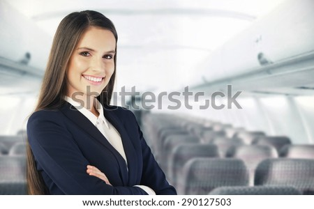 Flight attendant waiting for the passengers to board
