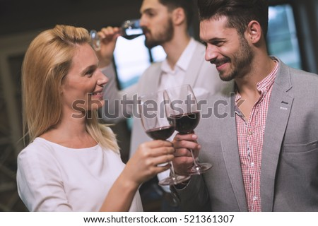 Flirting woman at party with jealous partner