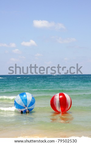 floating red and blue balls at mediterranean sea