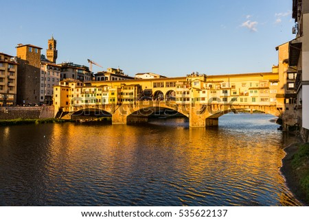 FLORENCE, ITALY - JULY 16, 2016: View of the Ponte Vecchio in Florence on July 16, 2016. Florence is the capitol city of the Tuscany region and very popular by tourist.