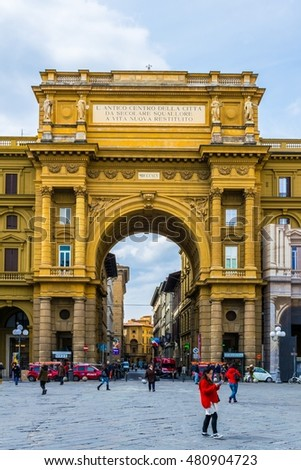 FLORENCE, ITALY, MARCH 15, 2016: people are strolling through piazza della repubblica square in the italian city florence which is dominated by a giant arch leading towards via degli strozzi
