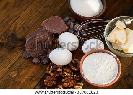 flour, butter, sugar, eggs, chocolate - ingredients for a batch of homemade chocolate cake brownie