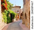 Flower lined street in the town of Assisi, Italy     - stock photo
