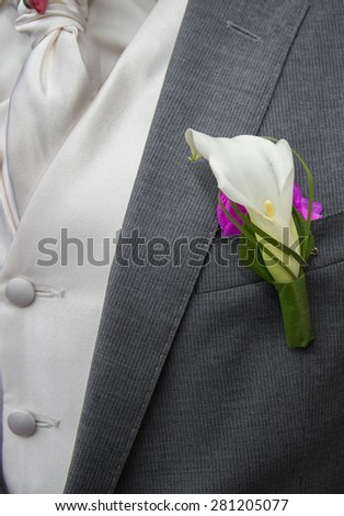 Flower on groom's jacket for a special day : wedding