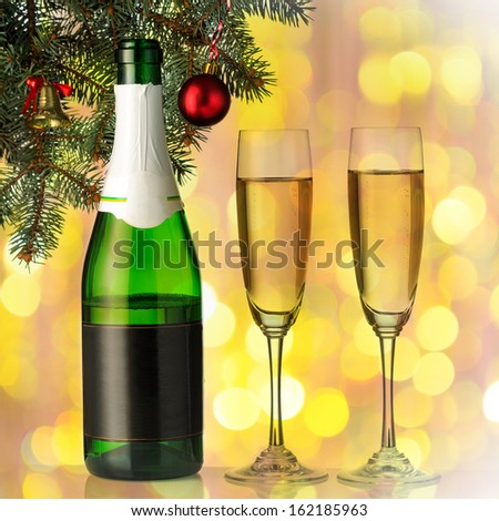 Flutes of champagne in holiday setting. Closeup.