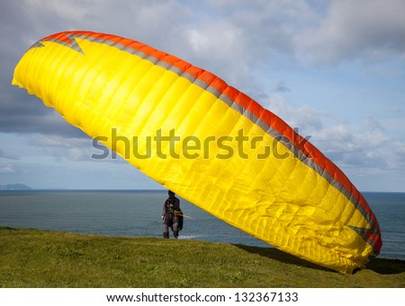 fly away paraglider on top of mountain