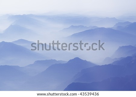 Flying over the mountains with clouds