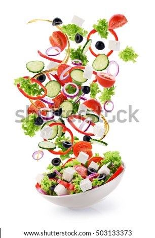 Flying salad ingredients isolated on white background. Greek salad.