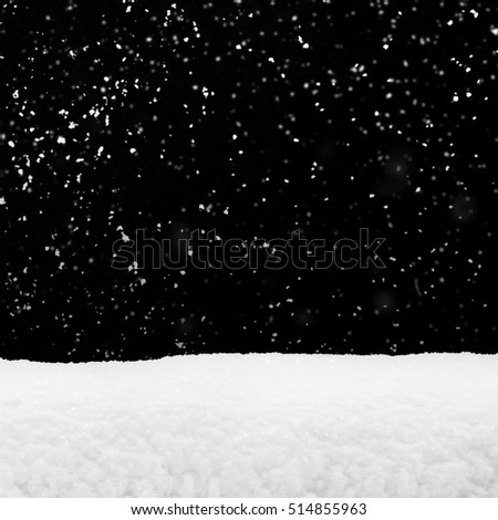 Flying snow crystals and snowdrift isolated on black, winter season