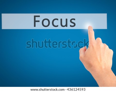 Focus - Hand pressing a button on blurred background concept . Business, technology, internet concept. Stock Photo