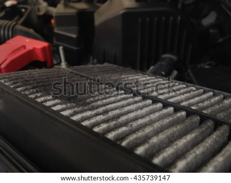Focus of Dirty Dust, soot on old used car air filter, decrease efficiency engine