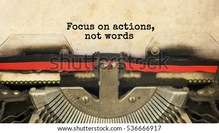 Focus on actions, not words typed words on a vintage typewriter with vintage background