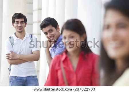 Focus on man with his friends in the foreground
